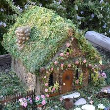 Lovely large fairy house with moss roof.