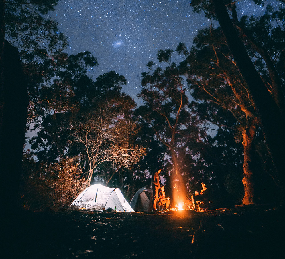 Camping underneath a star filled sky