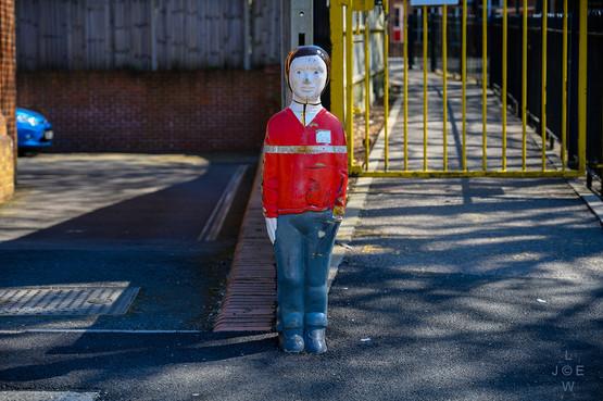 Child figure outside school gate