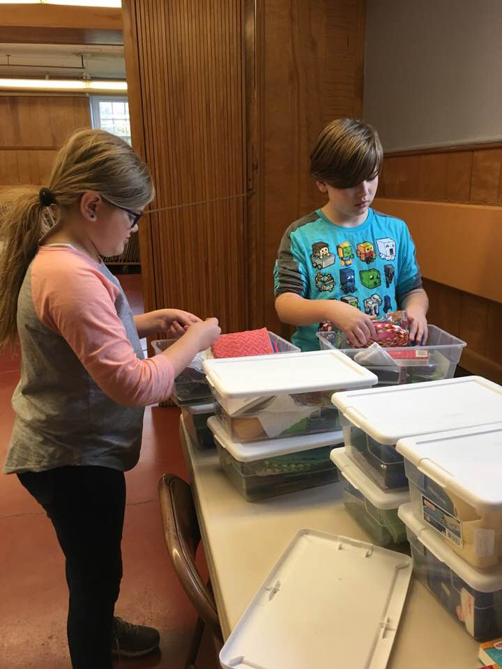 Josh and Elayna fill Operation Christmas Child boxes