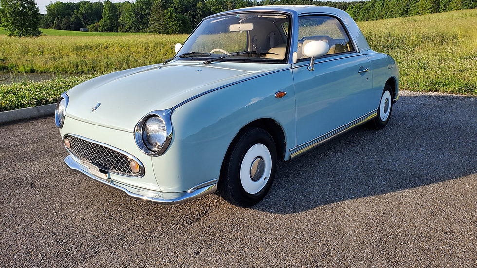1991 NISSAN FIGARO TURBO CONVERTIBLE IT HAS A 1.0 LITER 4CYLINDER TURBO