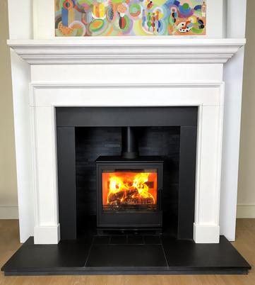 Deben M in Limestone fireplace