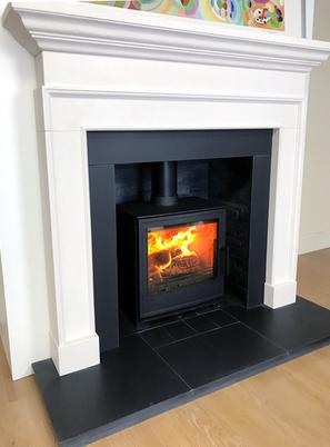 Deben M 5kW in Limestone fireplace
