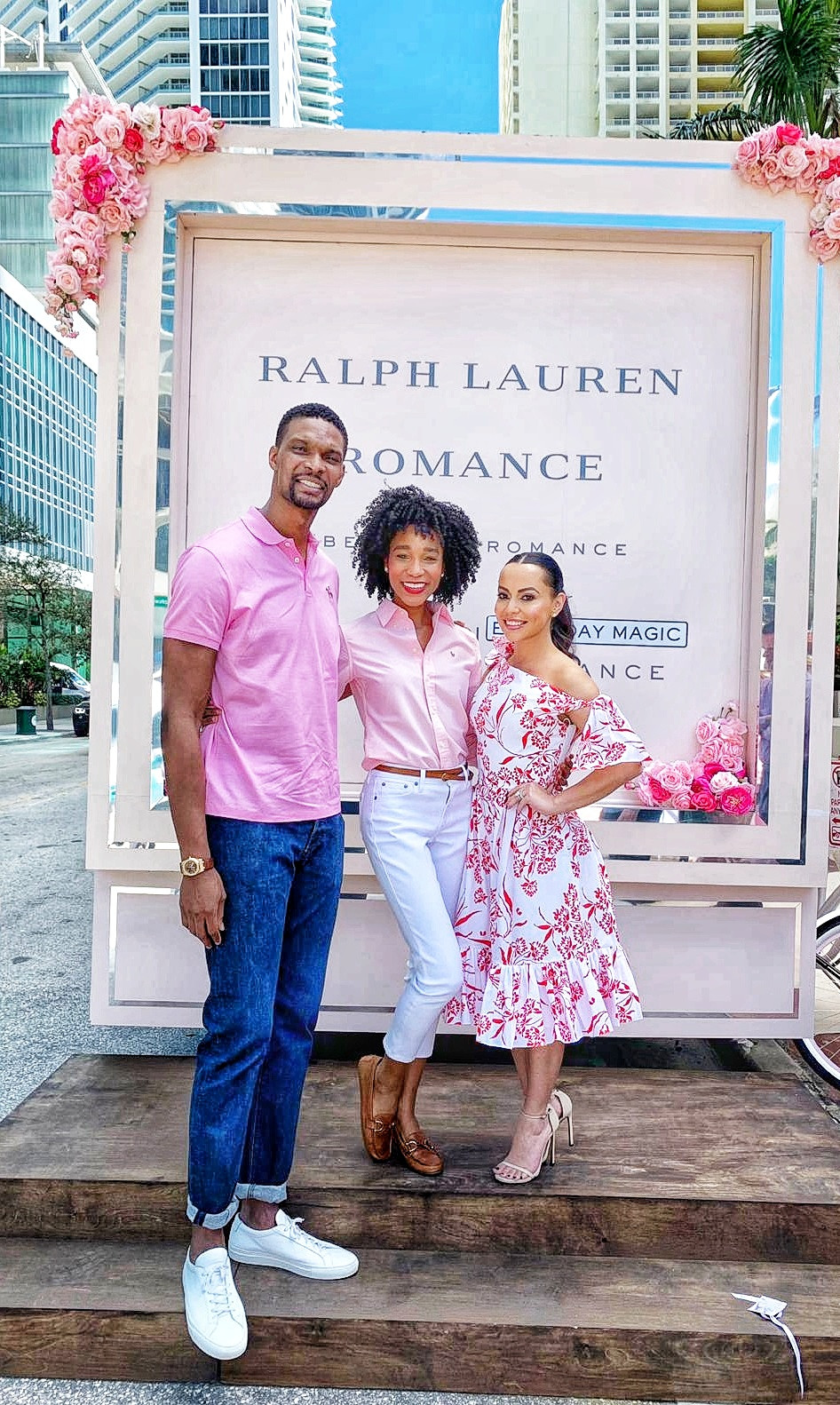 Basketball player Chris Bosh, his wife Adrienne & model Kamla-Kay outside by Ralph Lauren event truck