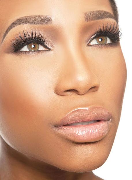 Kamla-Kay woman beauty headshot with false lashes