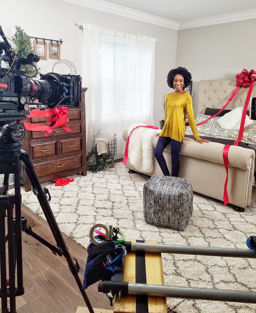 model woman Kamla-Kay on set tv commercial with camera in bedroom