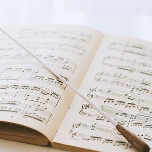 Conductor's%2520baton%2520on%2520sheet%2520music_edited_edited.jpg