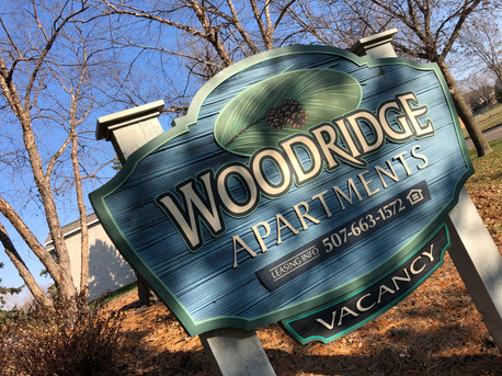 Woodrige Apartments Fall outdoor vacancy sign and contact information