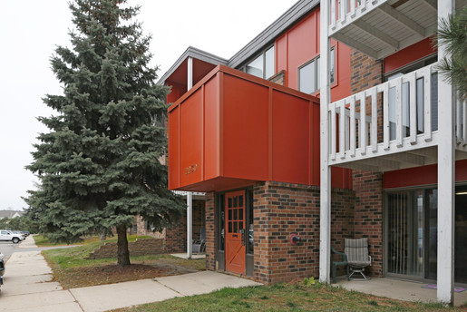 Hidden Valley Apartments new red paint with white decks and pine tree