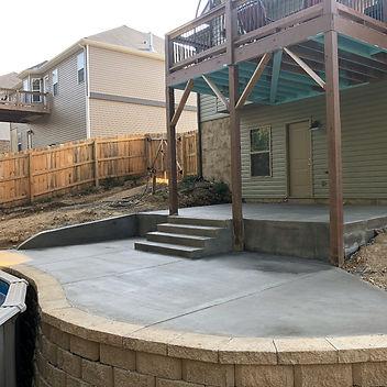 concrete back patio installed around pool