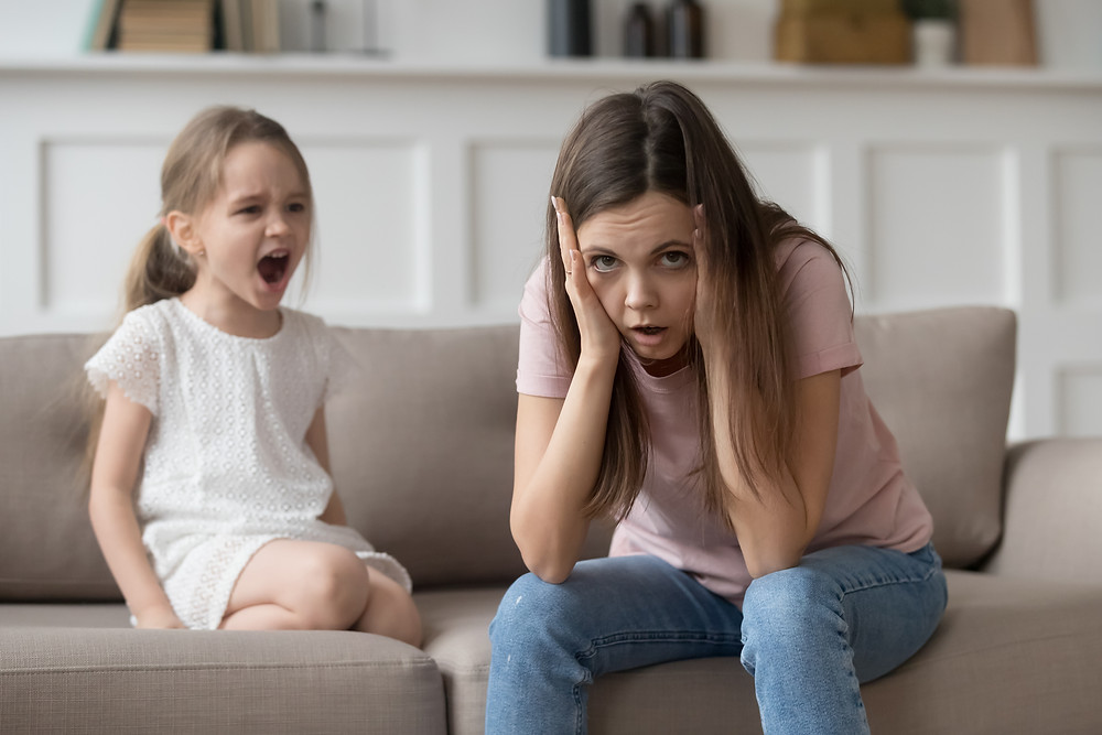 Exhausted mother with shouting child