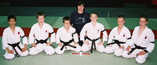 jane-and-junior-male-black-belts.jpg