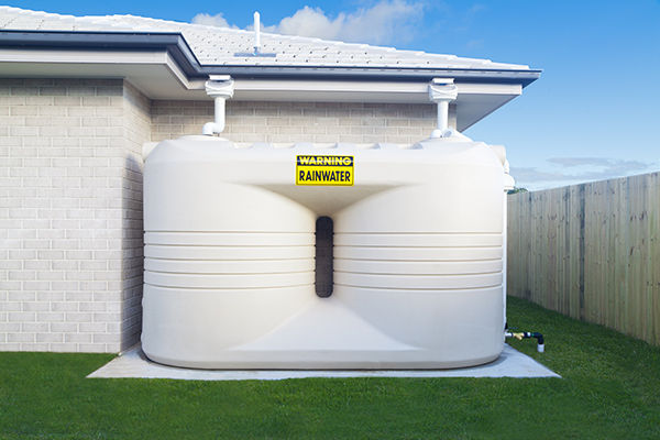 Water tanks to harvest rain water from gutters