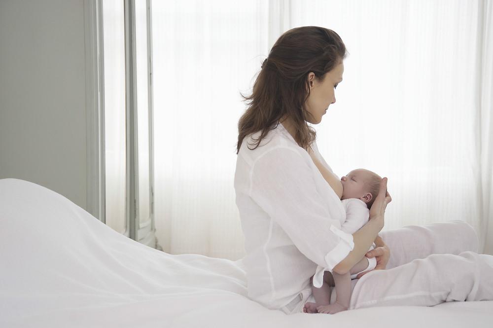 Mum breastfeeding her newborn baby