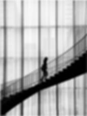 woman walking upstairs_landscape.png