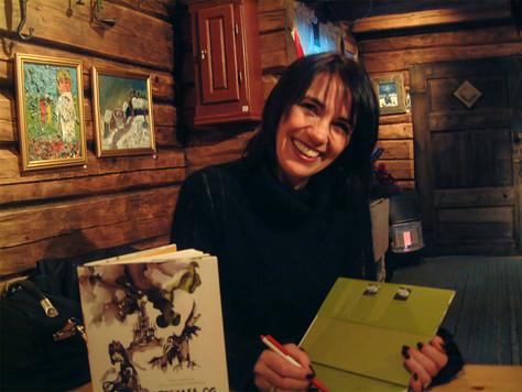 Randi signerer bok