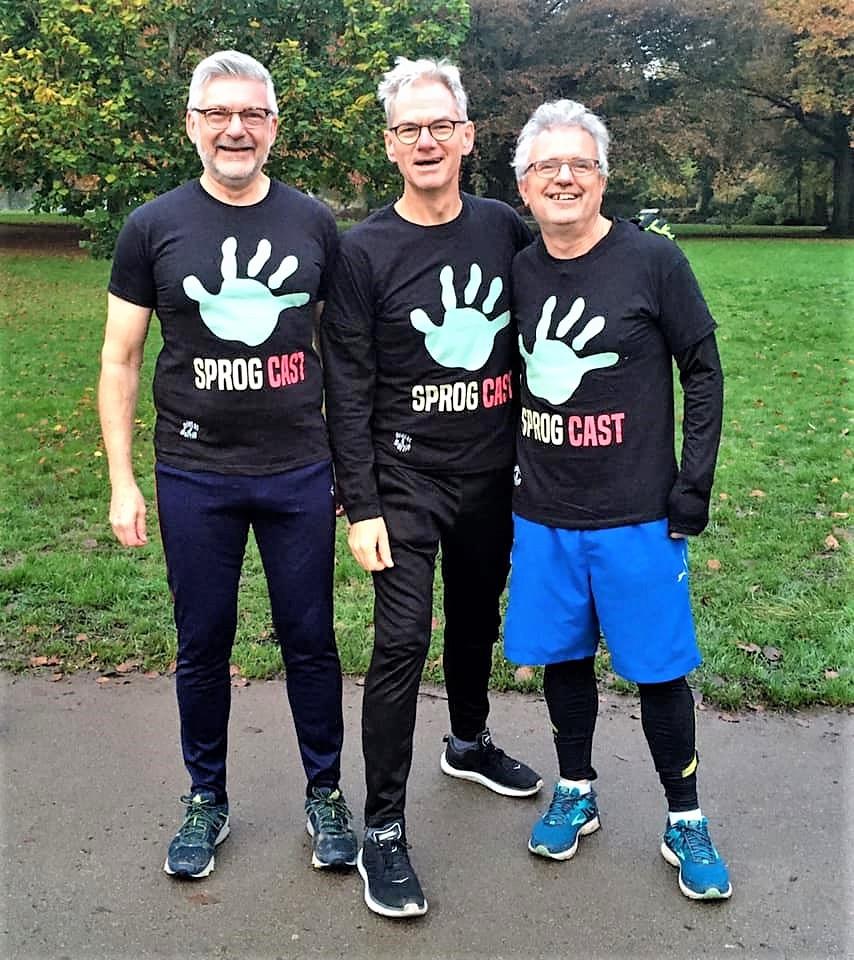 Older men exercising and smiling