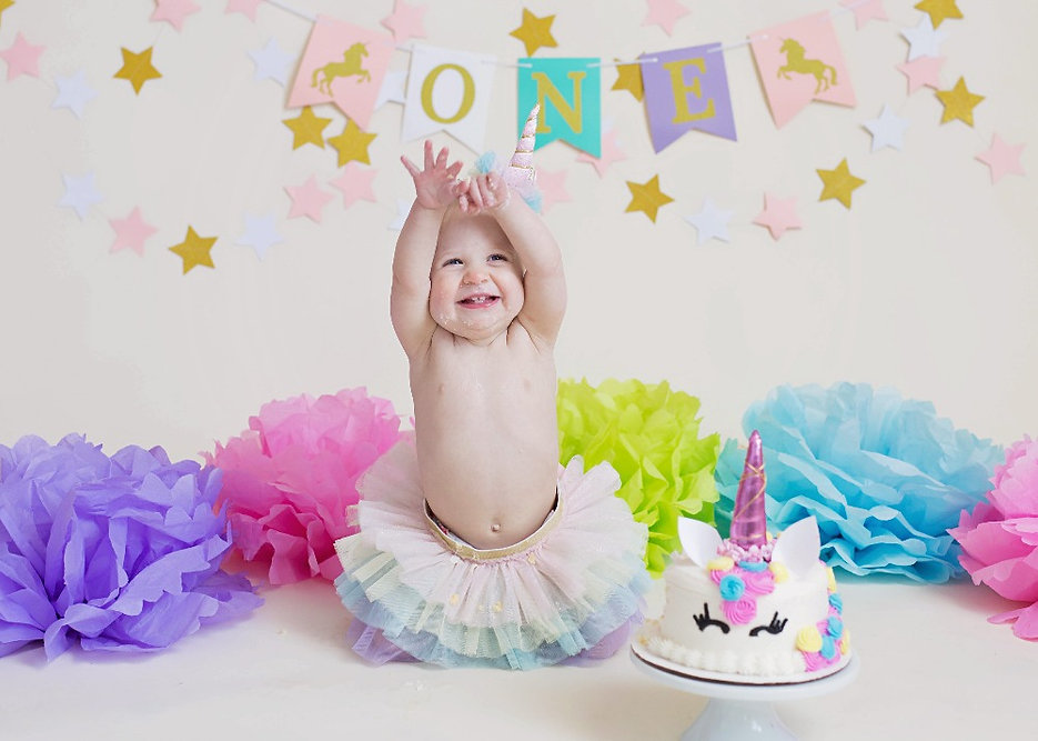 unicorn themed smash cake session with matching outfit and unicorn cake in studio Concord MA