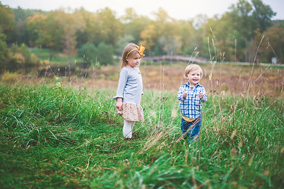 outdoor family session with toddlers outdoors in a field