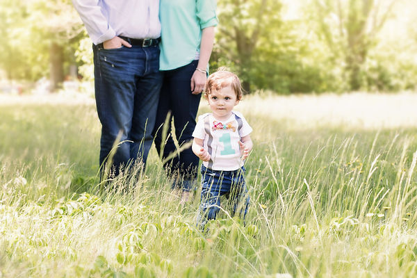 outdoor family session in a field with a baby