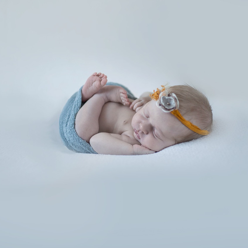 newborn baby posed with wrap