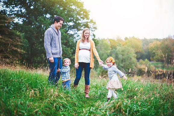 outdoor photography session of a family in a field
