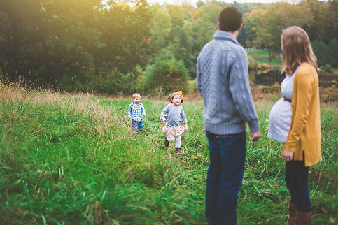unposed outdoor family session in a field in Concord MA