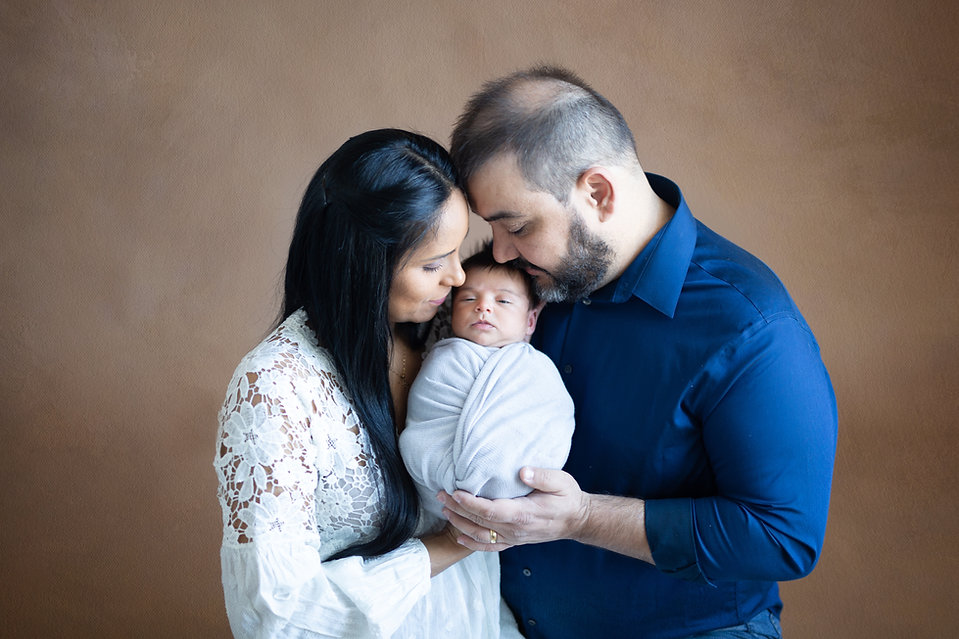 posed family photography for in-studio newborn session