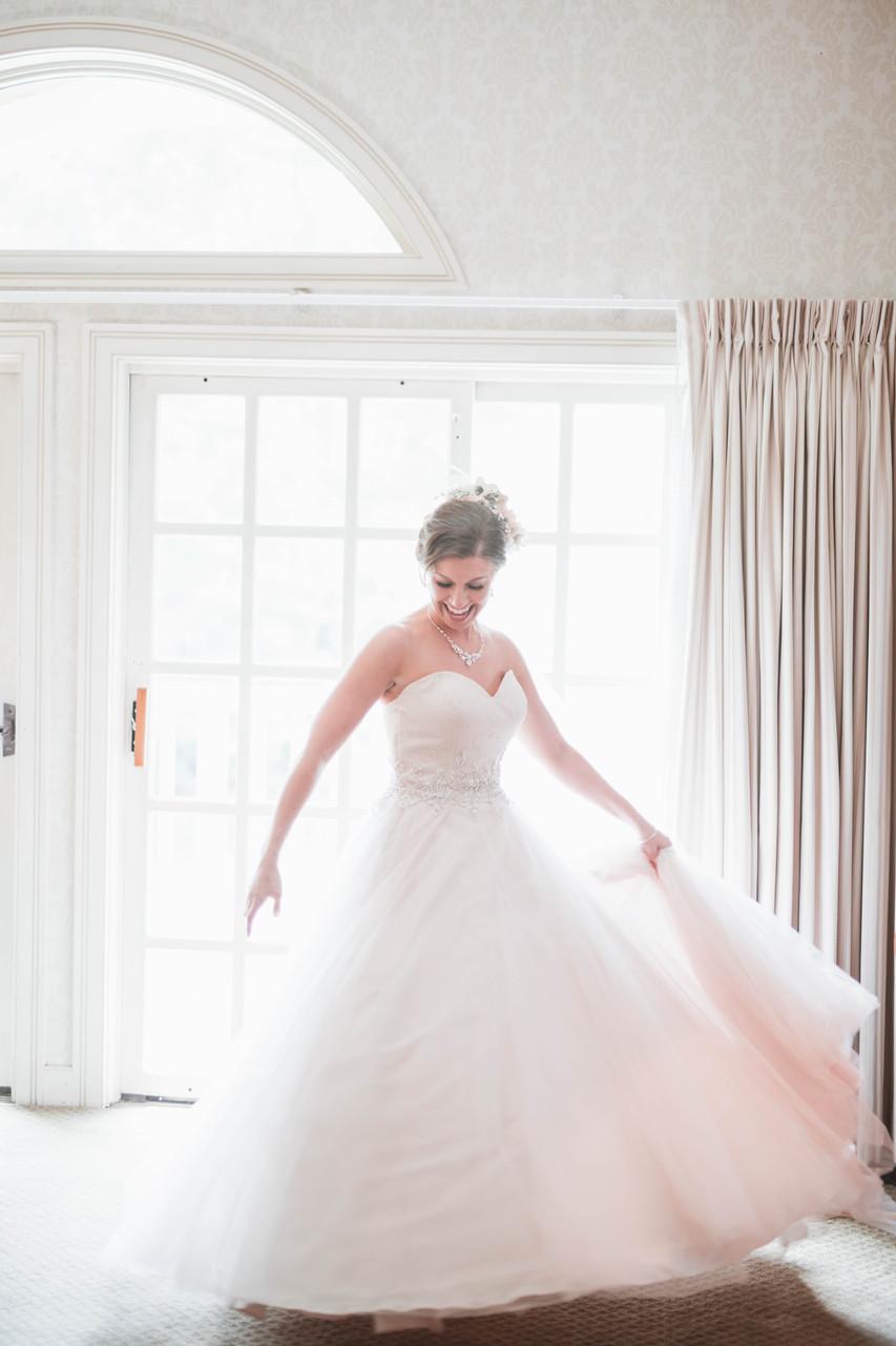 smiling bride blush dress