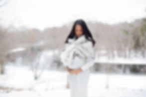 outdoor winter maternity session near river
