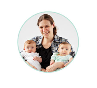 portrait of milk donor and recipient Carrie holding her two babies Hazel and Alexandria