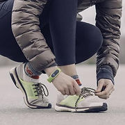 woman-athlete-tying-shoes_925x.jpg