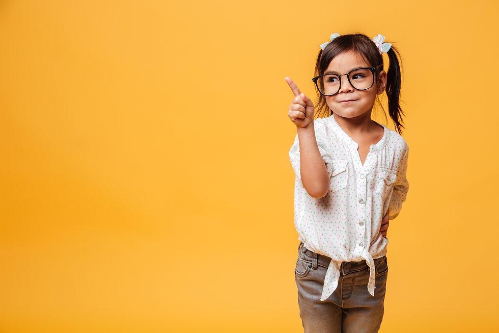 cute-little-girl-child-wearing-glasses-pointing.jpg