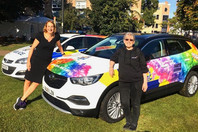 Emma & Jules with the Rainbow Police Car at Pride