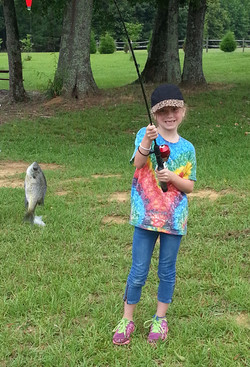 cwk girl camper catches a fish