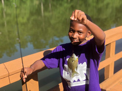 Summer camper catches fish at CWK