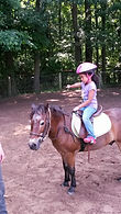 cwk girl camper doing horseback riding lessons