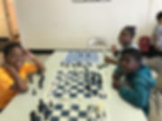 campers taking chess lessons at cwk
