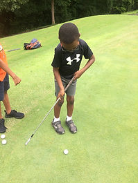cwk camper having golf lessons