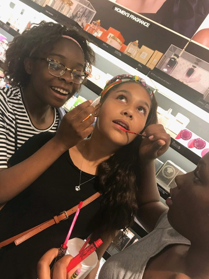 girls playing make up at Lenox Mall