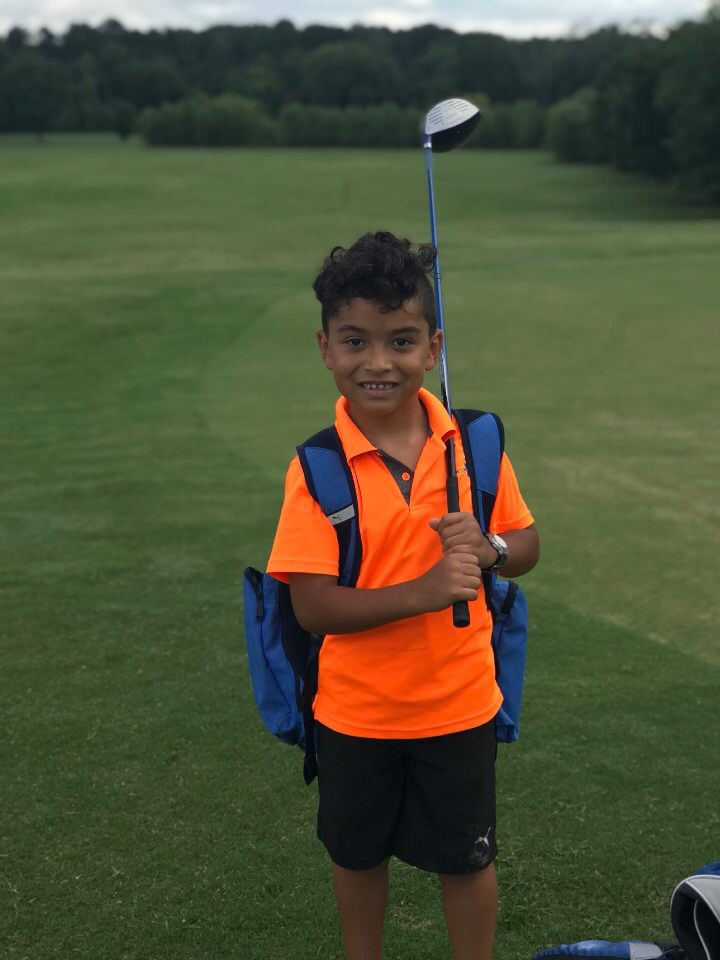 CWK camper enjoying summer golf