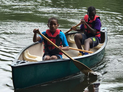 kids canoeing at CWK summer camp