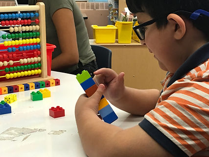 Young student counting math cubes