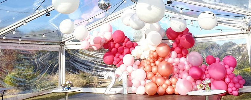 21st balloon backdrop in a marquee