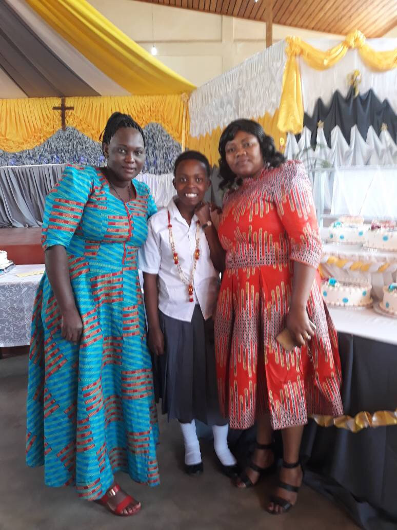 Eliza, her Mother, and Estahappy at graduation