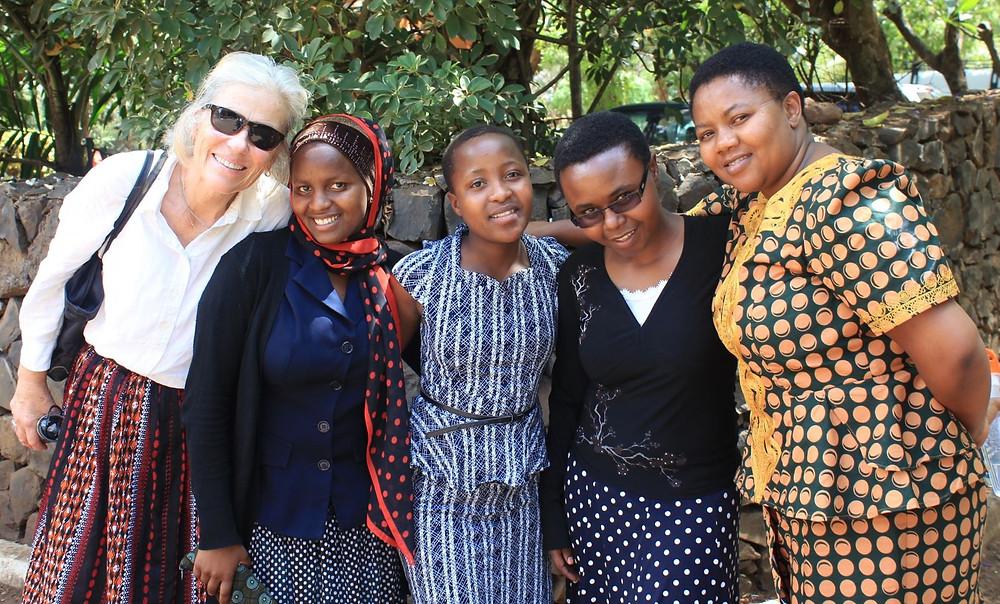 Nano, Mary, Melanie (10th grade student), Finyuely, and Estahappy at Mwenge Catholic University