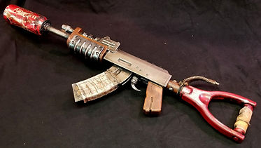Ak from the rust video game with custom coke can silencer with america on one side of the distressed can.