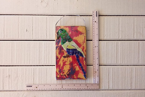 Parrot recyled glass on shipping pallet