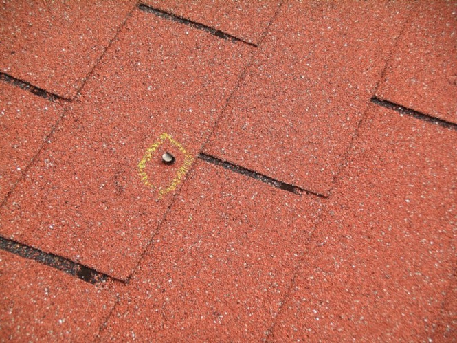 Popped nail on shingle roof.