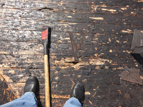 Mopped hot tar on wood